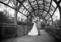 ivy archway shot of bride and groom